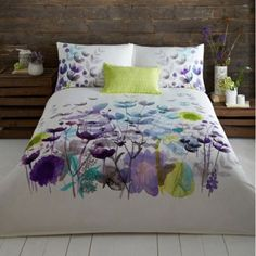 Perfect for adding a sophisticated splash of colour, this bed linen is designed by John Rocha and features a painterly floral print in deep blue and purple hues with bursts of lime green. The neutral cream cotton base is ideal for complementing the bold watercolour style print.