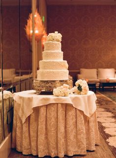 All 145 guests at this Four Seasons wedding danced to a 16-piece band, and enjoyed slices of this four-tiered wedding cake. Via Inside Weddings.