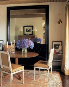 Love the Turkish oushak rug, dining table, chairs, mirror, etc. - gorgeous dining room. Elle Decor