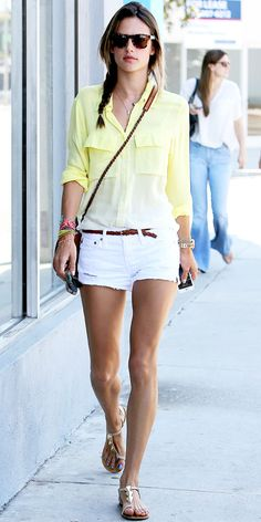 Even on a coffee run Alessandra Ambrosio looked impeccable. She tucked a yellow ombre button-down into white cut-offs, and paired her look with tortoiseshell shades, a leather cross-body bag and nude flat sandals.