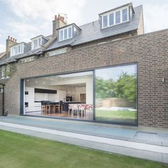 Lightwell spanning the width of this extension with basement below, with glass and grille, all constructed by London Basement