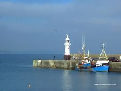 Lighthouse and boat at Mevagissey