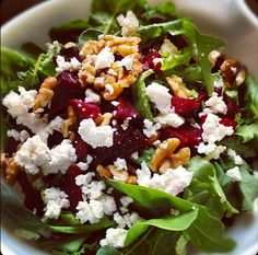A healthy & easy #salad #recipe which uses beets, goat cheese, candied walnuts & baby greens to make a yummy side dish.