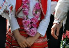 Traditional Bulgarian clothing and beautiful fresh roses, Bulgaria