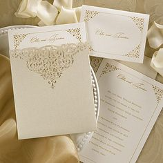 Through the Shimmer from Carlson Craft.  A detailed border design is on this latte shimmer invitation with your names at the top and will be seen after it is slid inside an elegantly laser cut gold shimmer pocket. #weddinginvitation