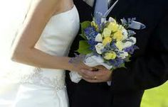 Bride and groom with her flowers