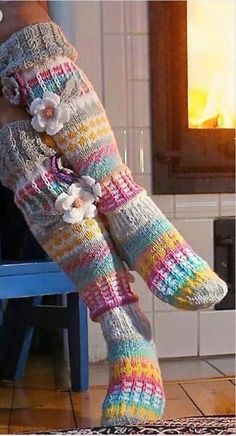 Knee high flower socks hand knit with crochet leaves and flower embellishments. These are warm and thick socks that can be worn with roomy boots/shoes