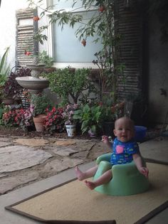 Baby enjoying afternoon by fountain garden