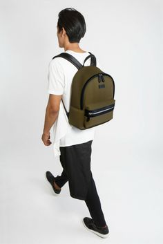 Olive green backpack crafted in vegan leather and neoprene. It works  perfectly as a travel d9a1893c1fc