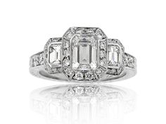 this is my vision of perfection .. 3 stone pave with halo emerald cut diamond in bezel setting engagement ring