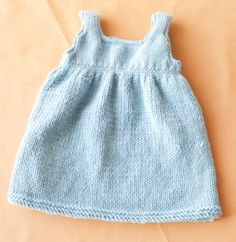 Knit baby sweater dress in luxurious Superwash Merino Cashmere by Lion Brand