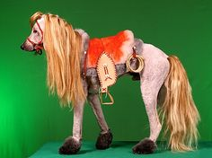 Creative grooming of an Afgan hound / designed to be a real rocking 'horse ' for young member of the family / poor dog is embarrassed to go out so saves on dog walking duties too / or increases time required to walk dog , as need to drive miles before dog will get out of the car !! ✔️