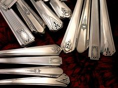 "An assortment of silver-plate patterns in Art Deco Styles all from the 1930""s"
