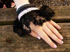 Handmade wrist cuff by LiliTheWeirdPrincess on DeviantArt