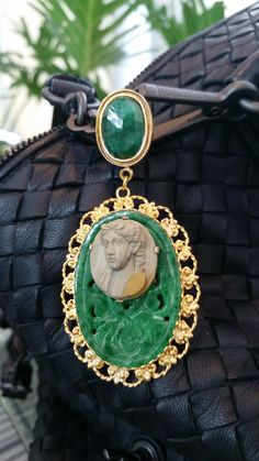 """Item Description:   19th Century Lava Cameo pendant mounted on carved jade and accentuated with an emerald and set in 10K solid yellow gold filigree  Condition:     19th Century                         Dimensions:       Approximately 3.25""""  x  1.75"""""""