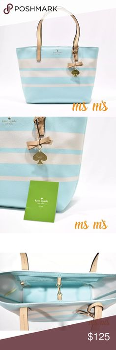 """NWT Kate spade small striped blue tote PRODUCT DETAILS: Grainy vinyl with leather handles Gold tone hardware Signature spade charm Double handles, 8.25 inch drop Top dog clip closure Inside zipper pocket Inside slide pocket Unlined Approx: 13 (L) x 9 (H) x 4 (W).                                          Top opening is about 13"""", bottom is about 11"""" kate spade Bags Totes"""