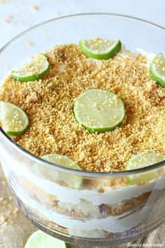 Key Lime Cheesecake Trifle - An easy and pretty dessert made with layers of graham cracker crust, cubed pound cake, and a key lime cheesecake filling. I'm going to put real key limes in this. Desserts Keto, Trifle Desserts, Delicious Desserts, Dessert Recipes, Yummy Food, Dessert Trifles, Dessert Ideas, Party Desserts, Plated Desserts