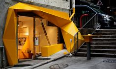 Konzepp à Hong Kong  Je vous présente un petit concept store baptisé Konzepp à Hong Kong.  Sa façade asymétrique jaune est le résultat d'une explosion de pixels à la fois disgracieuse et gracieuse d'après les créateurs.