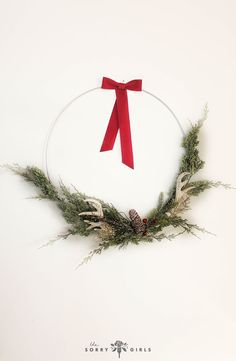 This is not your grandma's wreath! Click through to learn how to make your holiday decorations modern! Modern Christmas, Christmas Holidays, Christmas Decorations, Xmas, Christmas Ornaments, The Sorry Girls, Sparkling Lights, Jolly Holiday, Diy Crafts