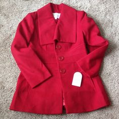 Jessica Simpson New with tags - size large. Beautiful chic bright red color perfect for this winter! Has flare to define the curves! I won't be be able to model this because this isn't my size. I bought it thinking I might need a larger size during pregnancy.... Jessica Simpson Jackets & Coats