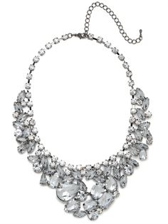 With its grand cluster of over-sized ice-white crystals — all elegant shapes and sizes — this necklace is both sophisticated and oh-so-glam.