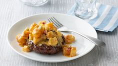 Bake these cheesy burgers and frozen hash browns in foil packets on the grill for easy cleanup.