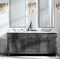 RH's Annecy Metal-Wrapped Double Vanity:Drawing inspiration from French industrial designs of the early 20th century, our collection features hand-wrapped sheet metal with an antiqued finish applied by hand. Its warm patina only grows richer over time.