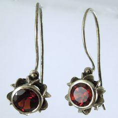 Round Cut Garnet Earrings. Set in Sterling Silver.$175