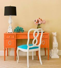 Bright orange paint minimizes intricate details and brings this desk into modern fashion while silver details add sparkle: http://www.bhg.com/decorating/makeovers/furniture/before-and-after-furniture-makeovers/?socsrc=bhgpin120814modernface&page=2