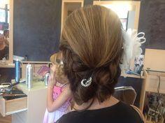 Two side braid into a low bun