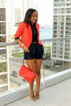 Monocolor navy shorts and fitted shirt mimic the look of a romper. Love it with bright poppy blazer, bag, and heels for day-to-night.