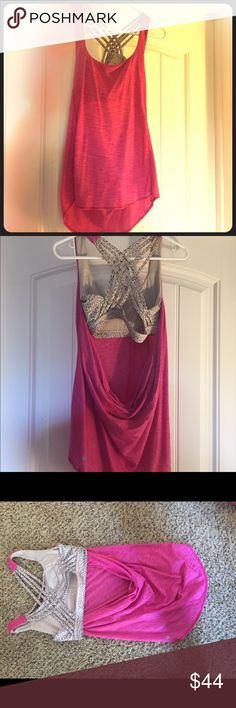 Lululemon Wild Tank Heathered Pink size 8 Great condition!very excellent Lightly used heather pink tank! It has a built in Bra! lululemon athletica Tops Tank Tops