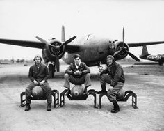 "The crew of a A-20 ""Havoc"" of 416 7th bomber group, sitting on the bombs in front of their aircraft 1944.."