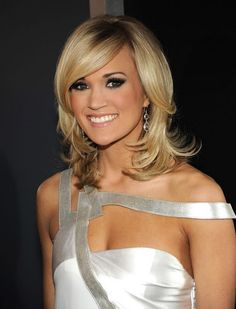 I love this hair cut... i just dont want to cut my hair right now.. maybe this summer...=)