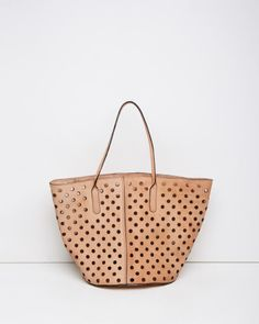 Rachel Comey; a natural leather tote with perforations throughout & contrast edging.