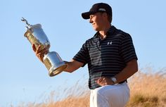 Jordan Spieth of the United States poses with the trophy - Ross Kinnaird/Getty Images