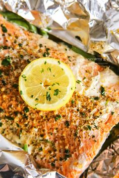 Garlic Butter Salmon is a simple foil packet dinner recipe that's oven-baked for a quick & healthy dinner or made on the grill at your next backyard BBQ. Salmon Foil Packets Grill, Foil Packet Dinners, Butter Salmon, Grilled Salmon, Backyard Bbq, Garlic Butter, Oven Baked, Fish And Seafood, Salmon Recipes