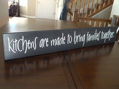This Kitchen sign by American Woodcrafts, LLC features the humorous saying, Kitchens are made to bring families together. Wood sign is beautifully designed to add to your home decor. We never use vinyl stickers on our signs, you can expect the lettering to last and remain beautiful. Wooden sign measures 5.5x36 and comes ready to hang with a keyhole slot which allows your sign to hang flat against the wall. This wood sign with saying would be a great addition to any kitchen decor. Choose your…