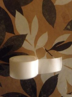 This is an adhesive tape. It is made of Cellophane (biodegradable). It is a thermoplastic.