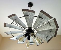 "Bold, Unique, Current & Dramatic! LampGoods' lead designer has done it again with this 4-light chandelier featuring an original, heavy galvanized windmill. * 30"" wide and 9.5"" tall. * Heavy Metal Wind"