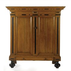 A DUTCH OAK AND EBONISED CUPBOARD 17TH CENTURY AND LATER
