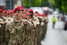 The Red Berets of the Army's 111 Provost Company Royal Military Police are pictured on parade in Bergen, Germany.