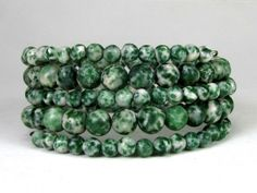 * * Coiled memory wire bracelet with green spot jasper beads, 8mm and 6mm  * Green jaspers promote harmony, a sense of well being, and bring properties * Memory wire has a 2 1/4 diameter *  This is a