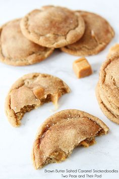 Brown Butter Snickerdoodles Stuffed with Caramel and a sprinkle of sea salt! Recipe on www.twopeasandthe...