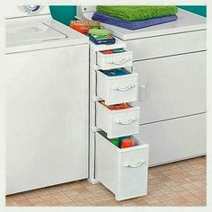 LOVE these drawers! Take out bottom half of shoe closet to right of dryer, move dryer over and bam...insert drawers!