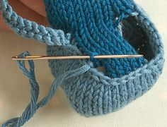 When you knit the top part of the foot you pick up 6 stitches and when it comes to sewing up you want to sew into the bar between the 2 outermost stitches on each side - this leaves 4 columns of stitches in the centre.  Perhaps these pictures will help?  This one shows the needle sewing through a purl bump on the back of the cast off row - this is where you need to sew through on the shoe part