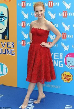 Jessica Chastain matches her fiery locks with a scarlet dress on Sunday at Italy's Giffoni Film Festival (July 2013)