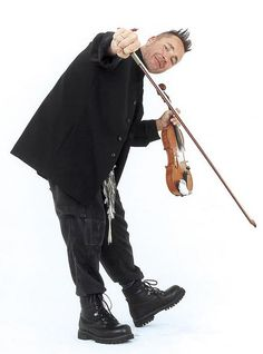 Nigel Kennedy at the Last Night of the Proms, bringing a cup of tea on stage having great fun - amazing violinist...entertaining everybody...