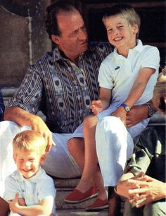 King Juan Carlos at his summer residence in Mallorca, Marivent, with Prince William and Prince Harry in the 80s.