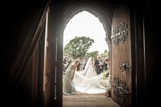 the bride standing outside to greet her guests while her bridesmaids fix her dress for her framed in by cathedral doors Stirling Castle, Cathedral, Wedding Photos, Wedding Photography, In This Moment, Wedding Dresses, Frame, Bridesmaids, Photo Ideas